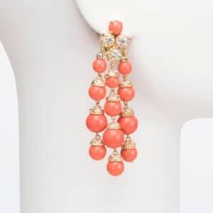 orecchino clip oro resina corallo