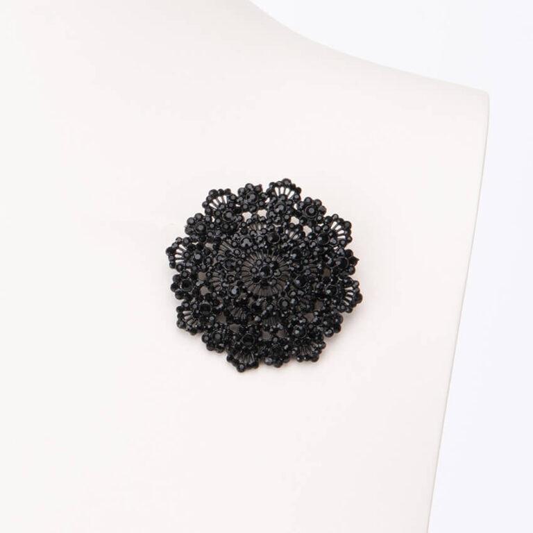 Spilla motivo arabesco cristalli neri