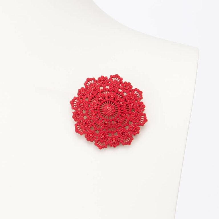 Spilla motivo arabesco cristalli rossi
