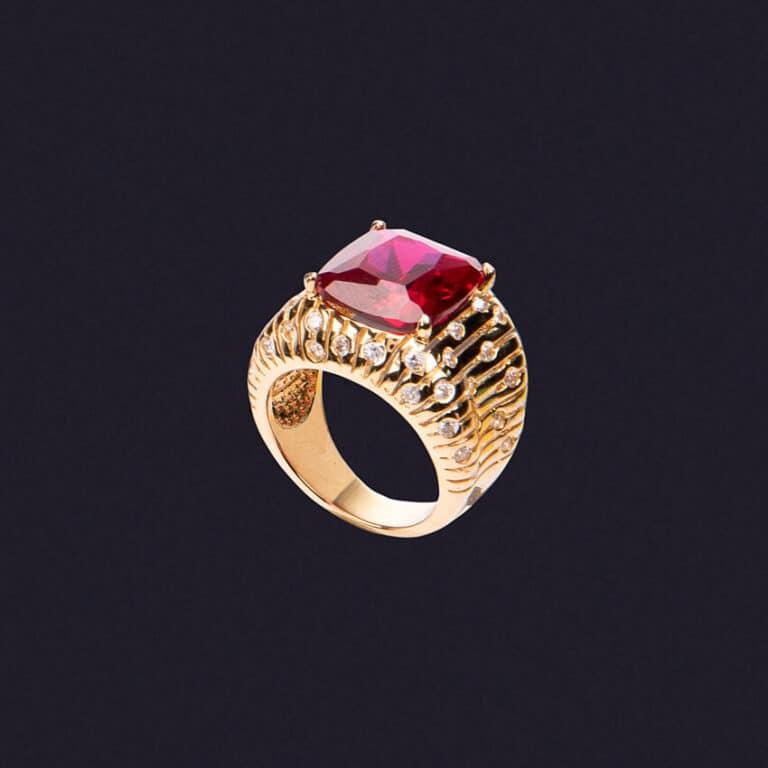 Anello fascia con pietra centrale color rubino 1