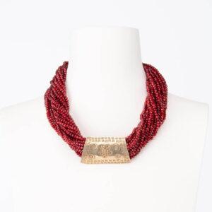 Collana girocollo cristalli rossi elemento etnico dorato