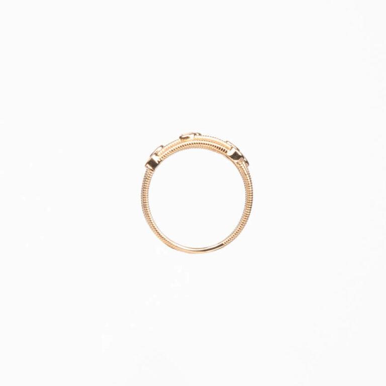 Anello a fascette oro intrecciate con zirconi bianchi 5
